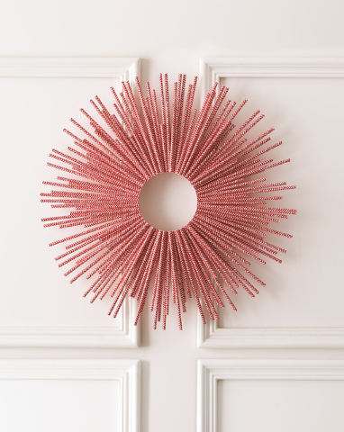 Courtesy Style at Home Dozens of colored straws encircle a wreath frame making a graphic statement piece for a holiday display and can be used well past Christmas.
