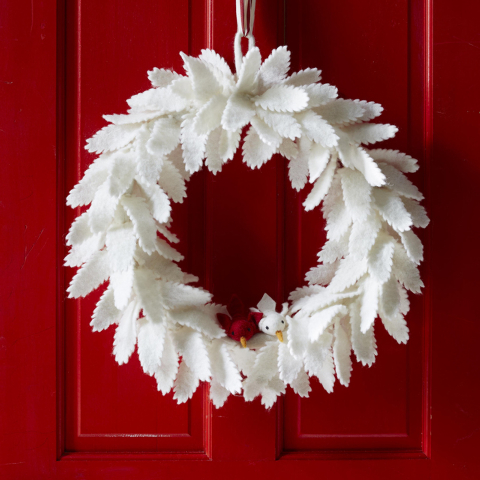 Courtesy West Elm Felt feathers in warm winter white give a sculptural quality to a soft wreath from West Elm.