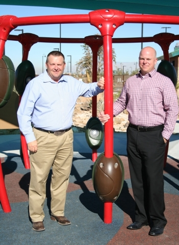 """Courtesy photo Inspirada park builder Guy Martin, left, and designer Andy Baron, right, try out the Neos interactive """"living game"""" in Potenza Park."""
