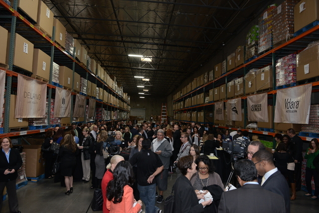 MGM Resorts employees gather for a special ceremony at Three Square Nov. 25. The company announced employees donated 1.6 million pounds of canned food to the food bank during this year's month-l ...