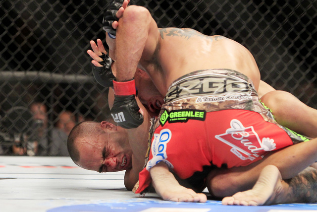 Donald Cerrone rains punches down on Eddie Alvarez during their fight at UFC 178 Saturday, Sept. 27, 2014 at the MGM Grand Garden Arena in Las Vegas. Cerrone won by unanimous decision. (Sam Morris ...