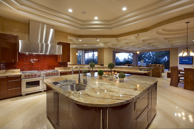This 11,460-square-foot home at 305 Rosegate Ave. in Henderson features a modern kitchen design. Kristen Routh Silberman of Synergy, Sotheby's International Realty has the listing for $3.8 million ...