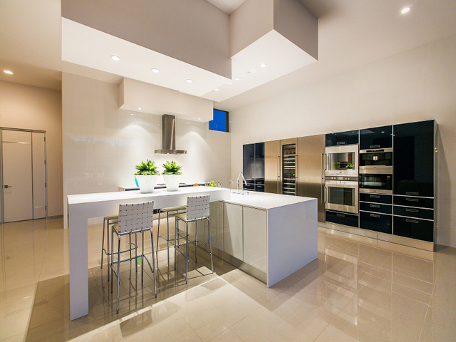Florence Shapiro with Berkshire Hathaway HomeServices Nevada Properties says luxury kitchen countertops have the more square or rectangular look of natural quartz surfaces that companies such as C ...