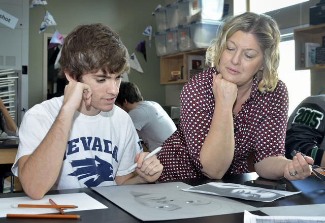 Teacher Lisa Hinricksen, right, works with Kyle Cooper during an advanced drawing class at West Career and Technical Academy at 11945 W. Charleston Blvd. in Las Vegas on Thursday, Dec. 18, 2014. ( ...