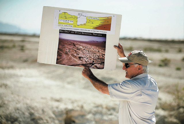 Stephen Rowland, professor of geology at UNLV, holds up a diagram and photo while guiding a tour of the proposed Tule Springs Fossil Beds National Monument Monday, March 17, 1014, in North Las Veg ...