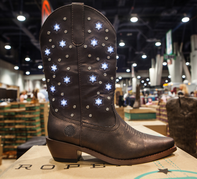 A pair of Roper Starlight boots  at  Cowboy Christmas Gift show in the Las Vegas Convention Center on Tuesday, Dec. 9,2014.  The company unveiled the motion activated lighted boots at this year's  ...