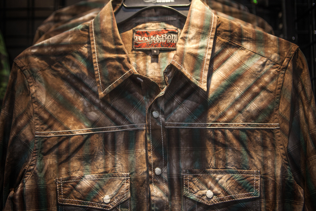 A snap button shirt is seen in the Rock & Roll Cowboy booth on Tuesday, Dec. 9,2014 during the  Cowboy Christmas Gift show in the Las Vegas Convention Center.The clothing company caters to the you ...