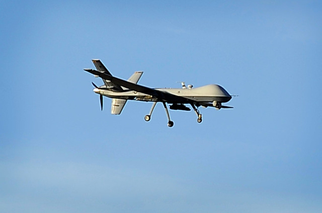 A MQ-9 Reaper drone flies over Creech Air Force Base in Indian Springs on Oct. 14, 2014. Nevada will host its first unmanned aerial systems flight when Minneapolis-based Sensurion Aerospace flies  ...