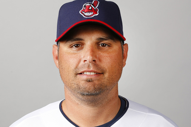 This is a 2014 photo of Kevin Cash of the Cleveland Indians baseball team. Cash was hired as the new manager of the Tampa Bay Rays on Friday, Dec. 5, 2014. (AP Photo/Paul Sancya, File)