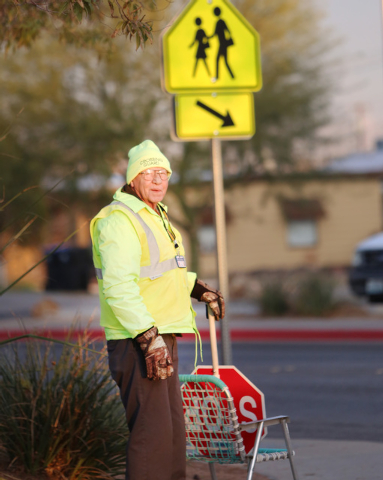 Jerry Enlow, 74, crossing guard, stands at the corner of Basic Road and Lead Street in Henderson, near McCaw Elementary School where he assists students across the street. Henderson is outsourcing ...