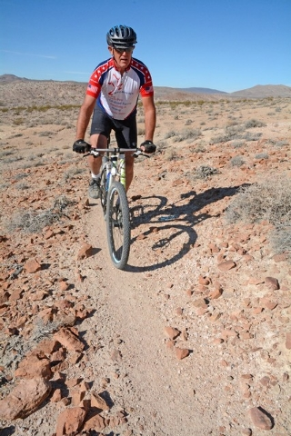 David Spicer, owner of Spicer Ranch, rides down a mountain in Beatty. He said this small town just 70 miles north of Pahrump should bring more traffic to Nye County once all the trails are built.  ...