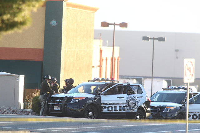 Las Vegas police respond to the scene where an armed suicidal man threatens to kill himself during a standoff on Decatur Boulevard near Charleston Boulevard in Las Vegas on Monday, Dec. 1, 2014. ( ...