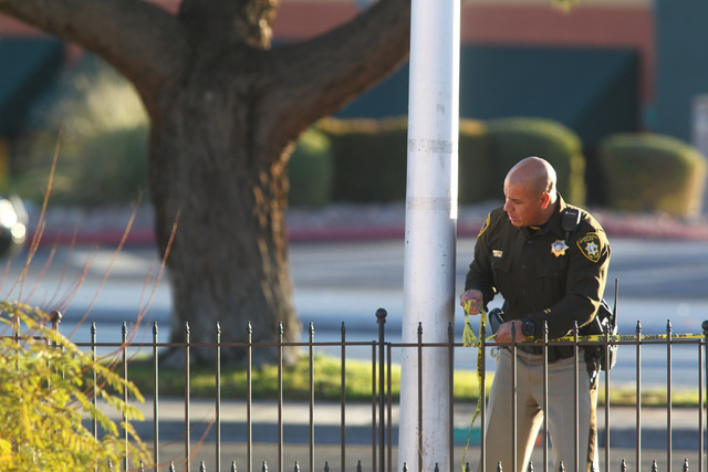 Las Vegas police respond to the scene where an armed suicidal man threatens to kill himself during a standoff on Decatur Boulevard near Charleston Boulevard in Las Vegas on Monday, Dec. 1, 2014. C ...