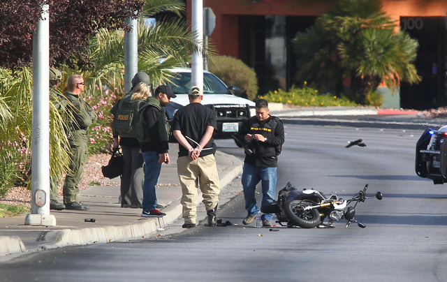 Las Vegas police detain a suicidal man who was armed after a standoff on Decatur Boulevard near Charleston Boulevard in Las Vegas on Monday, Dec. 1, 2014. (Chase Stevens/Las Vegas Review-Journal)