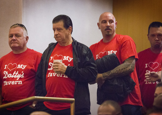 Supporters of Dotty's Gaming & Spirits taverns stand during the Clark County Commissioners hearing, 500 S. Grand Central Parkway, on Tuesday, Dec. 02, 2014. A pack chamber heard an ordinance that  ...