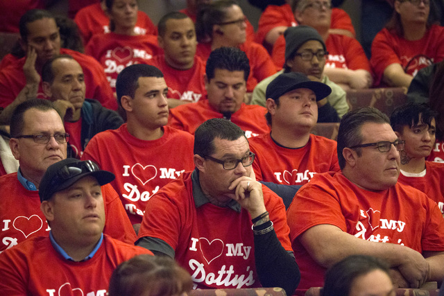 Supporters of Dotty's taverns listen during a Clark County Commission hearing Tuesday, Dec. 02, 2014, at the Clark County Government Center in Las Vegas. A packed chamber heard a proposed ordina ...