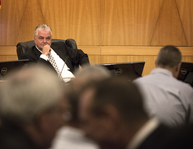 Clark County Commissioner Steve Sisolak listen while people line up to during public comment on the slot only tavern ordinance hearing on Tuesday, Dec. 02, 2014. A pack chambers heard an ordinance ...