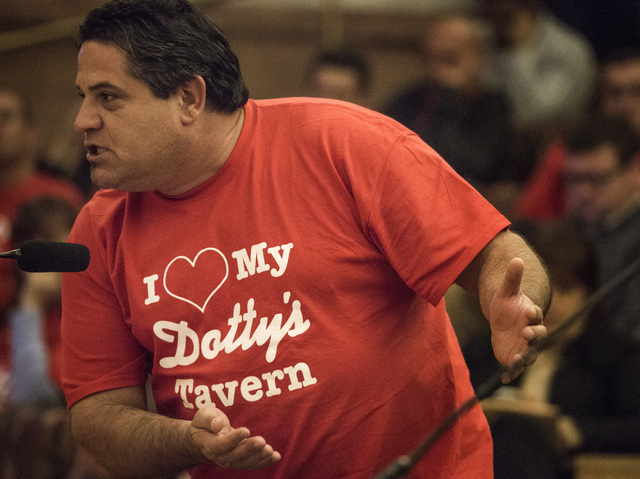 Dotty's Gaming & Spirits taverns worker Tony Hanshaw speaks during the Clark County Commissioners slot only tavern ordinance hearing  on Tuesday, Dec. 02, 2014. THe father of three girls has been  ...