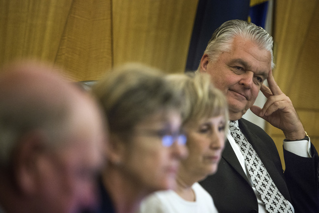 Clark County Commissioner Steve Sisolak, right, along with commissioners Tom Collins,left, Chris Giunchigliani and Mary Beth Scow during discuss the slot only tavern ordinance hearing on Tuesday,  ...