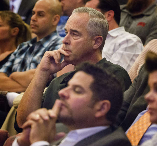 Blake L. Sartini, left, CEO of Golden Gaming, and Steve Arcana, chief operating officer of Golden Gaming, listen while the Clark County Commission  discusses  the slot only tavern ordinance hearin ...