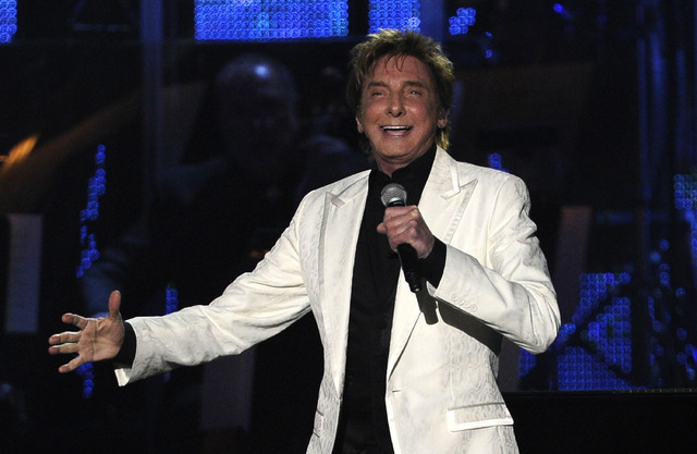 Barry Manilow performs at the MusiCares Person of the Year gala honoring Barbra Streisand on Friday, Feb. 11, 2011, in Los Angeles. (AP Photo/Chris Pizzello)