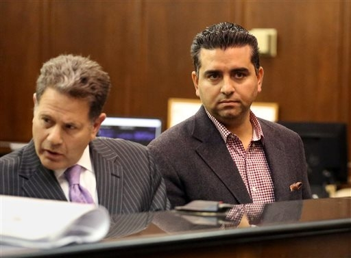 In this Nov. 13, 2014 file photo, Cake Boss star, Buddy Valastro, right, appears at his arraignment on drunk driving charges in Manhattan Criminal Court in New York. Valastro on Monday, Dec. 1, 20 ...