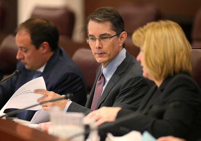 Members of the Economic Forum, from left, Matt Maddox, Ken Wiles and Linda Rosenthal work at the Legislative Building in Carson City, Nev., on Wednesday, Dec. 3, 2014. (Las Vegas Review-Journal/Ca ...