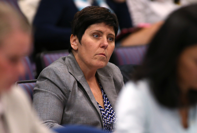Newly appointed Department of Taxation Director Deonne Contine listens to discussion at the Economic Forum meeting at the Legislative Building in Carson City, Nev., on Wednesday, Dec. 3, 2014. (La ...
