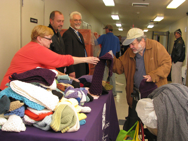Karin Roelf hands out her crocheted items to Catholic Charities of Southern Nevada clients Dec. 12 at 1501 Las Vegas Blvd. North. She has been donating her crocheted creations to the nonprofit for ...