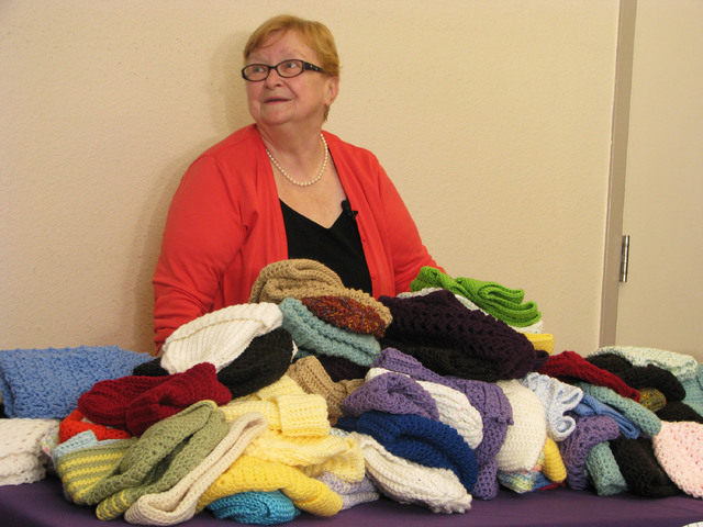 Karin Roelf delivered more than 100 of her crocheted items to Catholic Charities of Southern Nevada on Dec. 12. (F. Andrew Taylor/View)