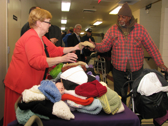 Karin Roelf hands out her crocheted items to Catholic Charities of Southern Nevada clients Dec. 12. (F. Andrew Taylor/View)