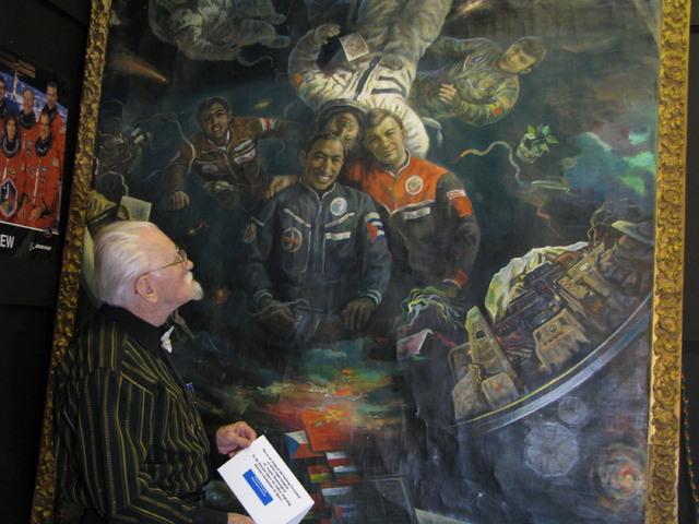 Peter Shields examines a painting in the Hammargren Exhibition Hall at the Hall of Antiquities inside The Boulevard mall. (F. Andrew Taylor/View)