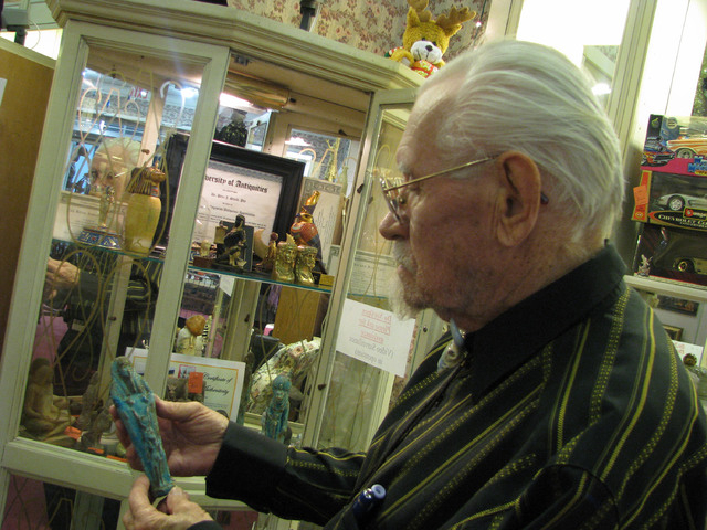 Peter Shields examines a curio inside his Hall of Antiquities at The Boulevard mall, 3528 S. Maryland Parkway. The Hall of Antiquities features unique memorabilia, some of which is from Shields' ...