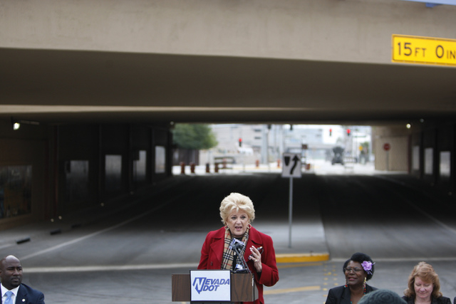 Las Vegas Mayor Carolyn Goodman, center, speaks during the reopening ceremony of F Street in Las Vegas near McWilliams Avenue and beneath Interstate 15 in Las Vegas Thursday, Dec. 11, 2014. Commun ...
