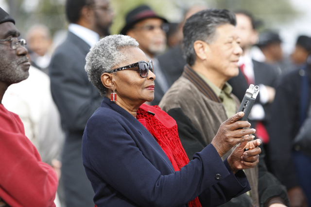 Claytee White, inaugural director of the Oral History Research Center for the University of Nevada Las Vegas Libraries, records audio during the reopening ceremony of F Street in Las Vegas near Mc ...
