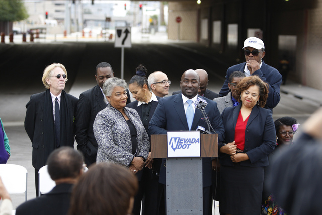 Councilman Ricki Barlow, center, speaks during the reopening ceremony of F Street in Las Vegas near McWilliams Avenue and beneath Interstate 15 in Las Vegas Thursday, Dec. 11, 2014. Community lead ...