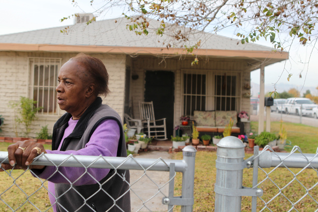 Ora Bland stands in front of her home during the reopening ceremony of F Street in Las Vegas near McWilliams Avenue and beneath Interstate 15 in Las Vegas Thursday, Dec. 11, 2014. Bland's home is  ...