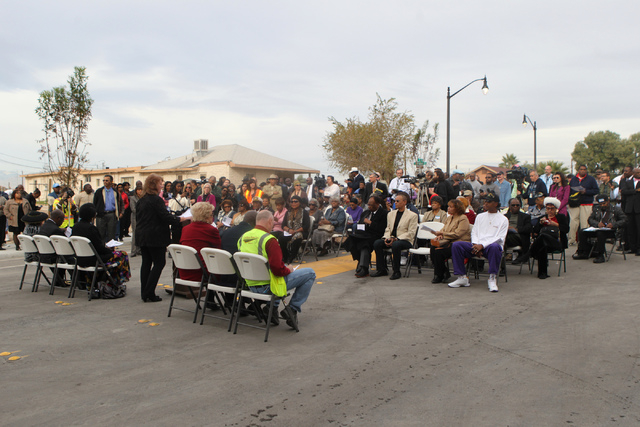 People gather for the reopening ceremony of F Street in Las Vegas near McWilliams Avenue and beneath Interstate 15 in Las Vegas Thursday, Dec. 11, 2014. Community leaders and government officials  ...