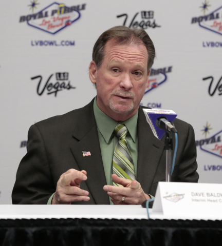 Colorado State University interim head coach  Dave Baldwin articulates a response to a reporters question during a press conference prior to the Royal Purple Las Vegas Bowl, in the Las Vegas Conve ...