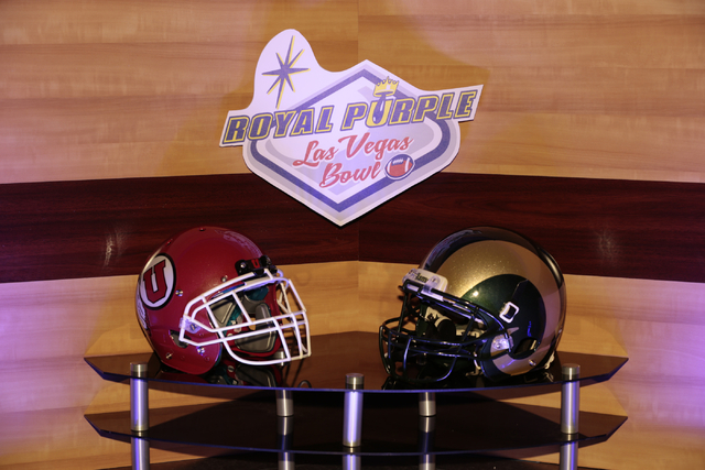 University of Utah and Colorado State football helmets on display in front of the Royal Purple Las Vegas Bowl logo during a luncheon,  in the Las Vegas Convention Center, Las Vegas, Friday, Dec. 1 ...