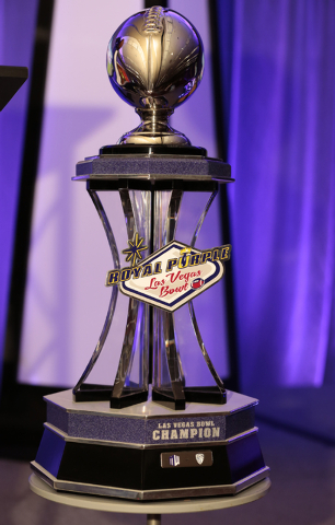 Trophy on display that will be awarded to the Royal Purple Las Vegas Bowl winning team, during the kickoff luncheon, in the Las Vegas Convention Center, Las Vegas, Friday, Dec. 19, 2014. (Donavon  ...