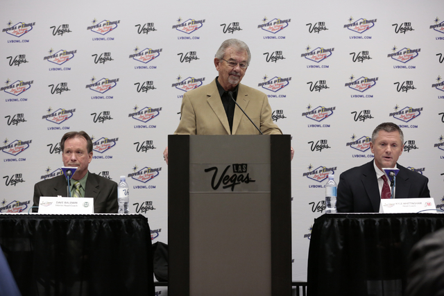 Colorado State University interim head coach  Dave - left Baldwin, Memcee for the press conference event Dick Calvert - center and  University of Utah head coach Kyle Whittingham- right , field me ...