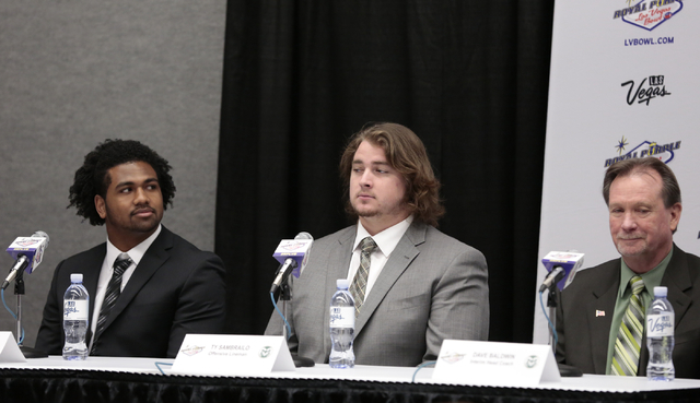 Colorado State University Aaron Davis - left, Ty Sambrailo - center, and  Dave Baldwin (interim head coach)- right , field media questions during the kickoff media conference prior to the Royal Pu ...