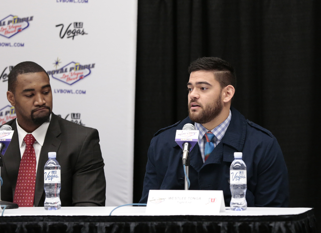 University of Utah defensive end Nate Orchard - left , listens as his team mate Weslee Tonga -tight end responds to a reporters question during a press conference prior to the Royal Purple Las Veg ...