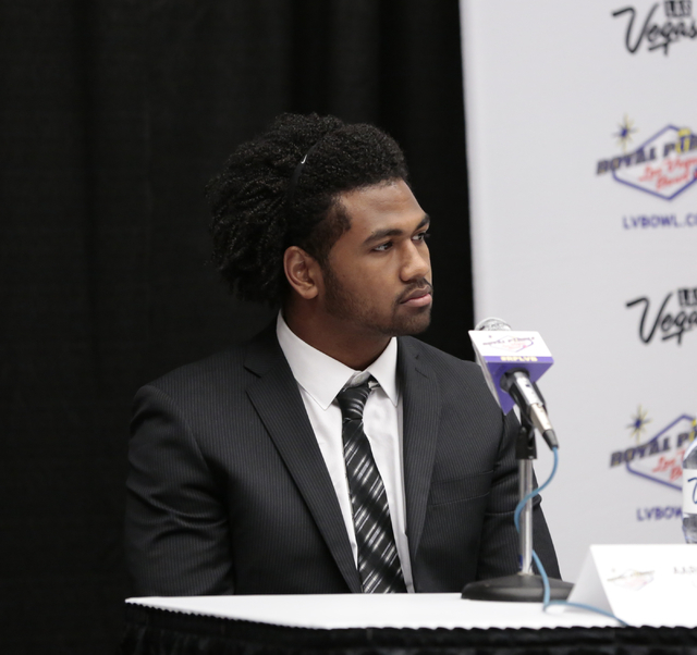 Colorado State University linebacker Aaron Davis listens to a question directed to him during a press conference prior to the Royal Purple Las Vegas Bowl, in the Las Vegas Convention Center, Las V ...