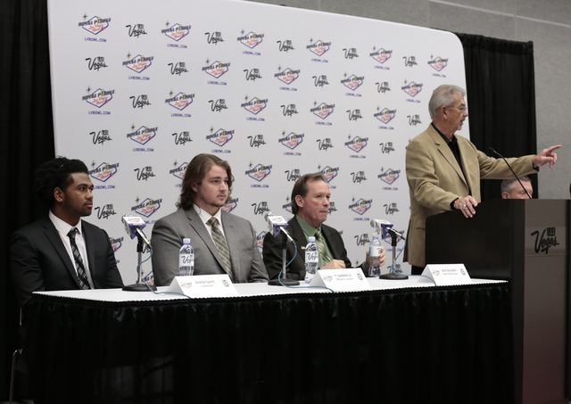 Colorado State University Aaron Davis - left, Ty Sambrailo - center, and  Dave Baldwin (interim head coach)- right and Emcee Dick Calvert fielding reporters questions, during the kickoff media con ...