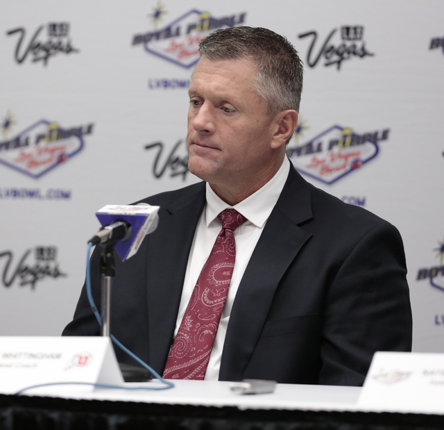 University of Utah head coach Kyle Whittingham  listens to  a reporters question during a press conference prior to the Royal Purple Las Vegas Bowl, in the Las Vegas Convention Center, Las Vegas,  ...