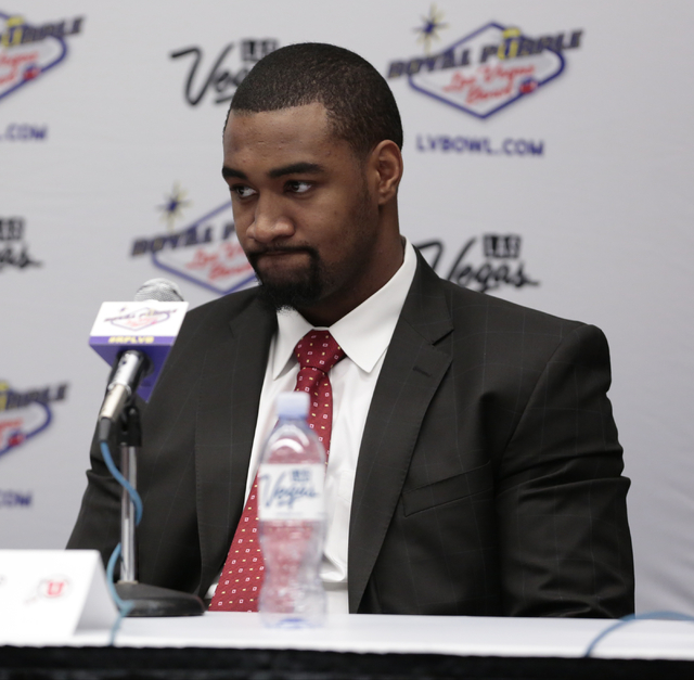 University of Utah defensive end Nate Orchard listens as a reporter poses a question to him during a press conference prior to the Royal Purple Las Vegas Bowl, in the Las Vegas Convention Center,  ...