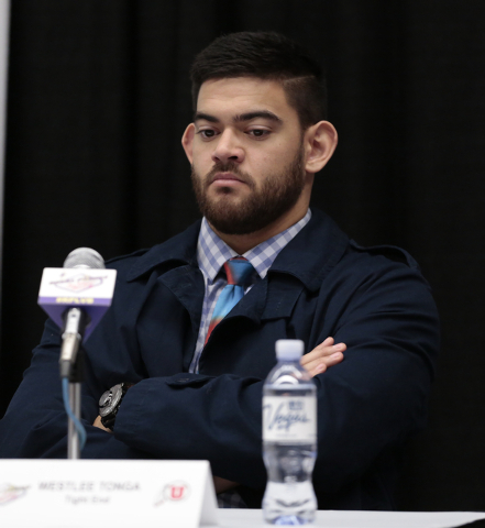 University of Utah Weslee Tonga - tight end, waits while others on the panel respond to reporters questions during a press conference prior to the Royal Purple Las Vegas Bowl, in the Las Vegas Con ...