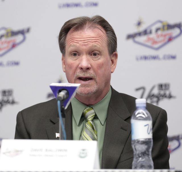 Colorado State University interim head coach  Dave Baldwin replies to a reporters question during a press conference prior to the Royal Purple Las Vegas Bowl, in the Las Vegas Convention Center, L ...